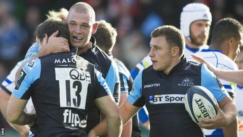 The Glasgow Warriors players celebrate after Mark Bennett scores against Bath