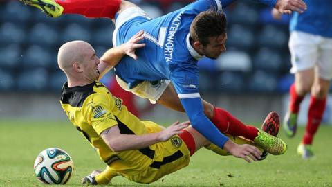 Cliftonville's Ryan Catney and Linfield striker Andrew Waterworth hit the deck during the Belfast derby at Windsor Park