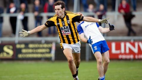 There's delight for Crossmaglen forward Jamie Clarke after scoring a goal but it's anguish for an Armagh Harps defender in the Orchard decider at the Athletic Grounds
