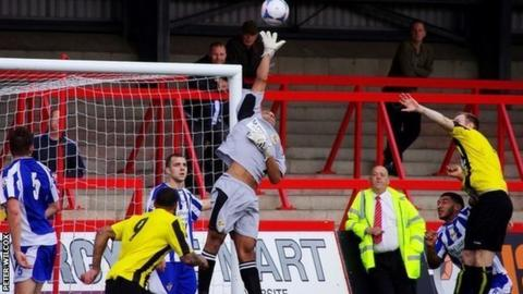 Worcester City stand-in keeper Wayne Thomas comes for a high ball in the 2-0 win over Harrogate