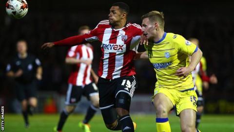 Andre Gray of Brentford holds off Sheffield Wednesdays Tom Lees
