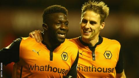 Bakary Sako of Wolverhampton Wanderers celebrates his goal with team mate Dave Edwards