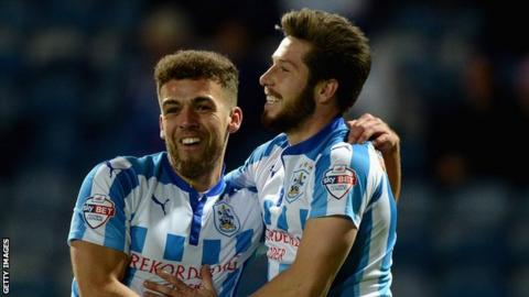 Jacob Butterfield (right) of Huddersfield celebrates scoring the opening goal with Tommy Smith