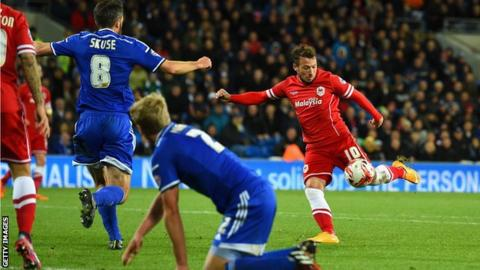 Adam Le Fondre prepares to shoot through a crowd of players to ensure the win for Cardiff against Ipswich