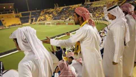 A crowd at a football match in Qatar