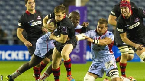 Tom Heathcote tries to escape the clutches of the Lyon players