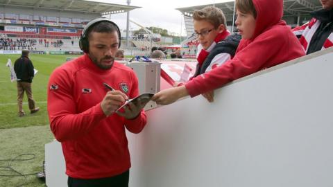 Young Ulster autograph hunters secure the signature of Springbok wing Bryan Habana before the lunchtime kick-off in Belfast