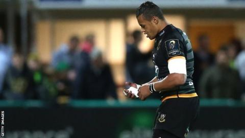 Luther Burrell holds his injured hand