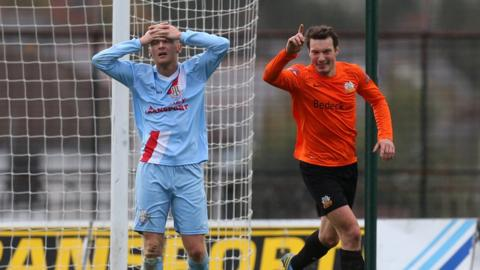 Contrasting emotions on show at the Showgrounds as Ballymena's Stephen McBride watches Glenavon's Kyle Neill celebrate his opening goal