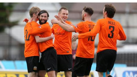 Glenavon players gather to congratulate Rhys Marshall after the full-back scores the third goal in his side's 4-1 win