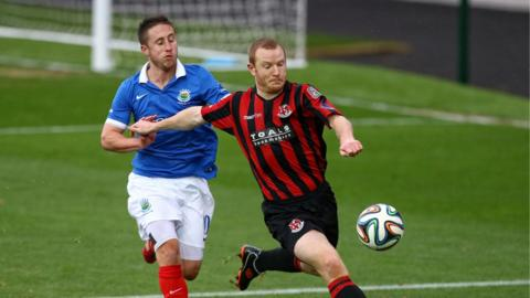 Michael Carvill and David Magowan vie for possession as Linfield go down to Crusaders who are now third in the table