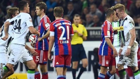 Bayern Munich and Borussia Monchengladbach players clash