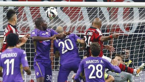 AC Milan midfielder Nigel de Jong heads his side into the lead against Fiorentina