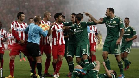 Olympiakos and Panathinaikos players argue during the derby between their sides