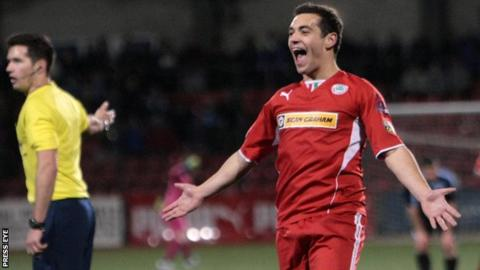 Substitute David McDaid hit Cliftonville's winner against Ballymena
