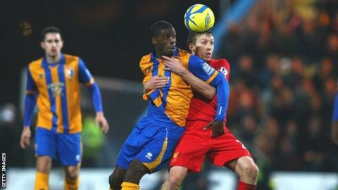 Athony Howell (centre) tussles with Liverpool's Lucas Leiva