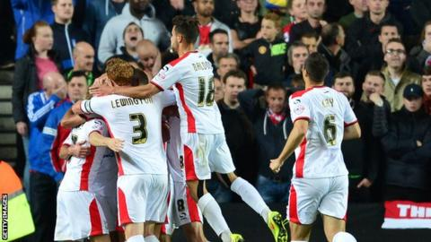 MK Dons celebrate during win over Manchester United