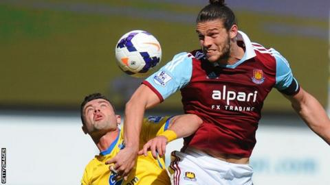 Andy Carroll wins a towering header to West Ham