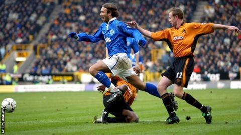 Blues striker Christophe Dugarry tangles with Wolves defender Jody Craddock, Molineux (November 2003)