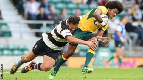 Henry Speight of Australia is tackled by Angus Ta'avao as the Barbarians come close at Twickenham