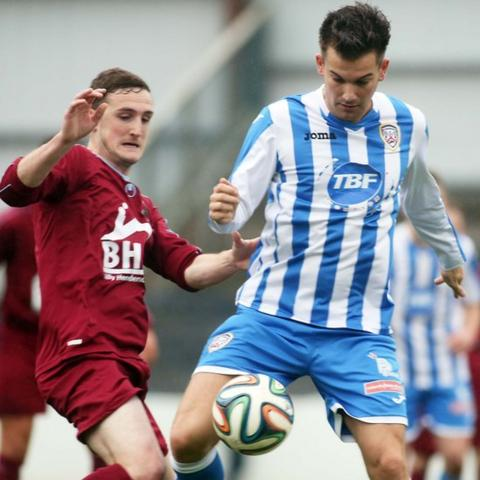 Stephen O'Donnell of Institute in action against Mark Miskimmin who scored a hat-trick in Coleraine's 4-0 win at the Showgrounds