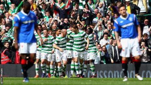 Celtic celebrate as they beat Rangers 3-0 in April 2012