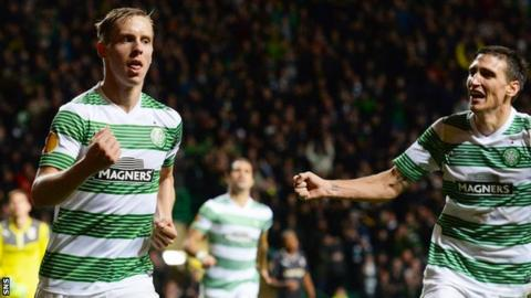 Stefan Johansen (left) celebrates scoring for Celtic