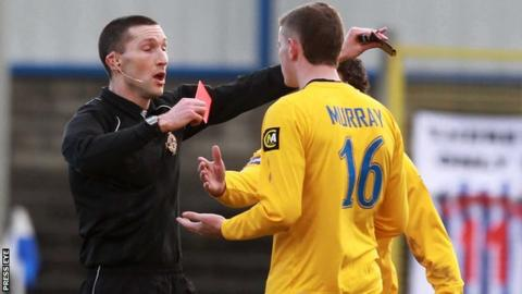 Mervyn Smyth hands out a red card in 2011