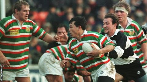 Tigers wing Rory Underwood scampers away with the ball during the 1995 game against the Baa-Baas