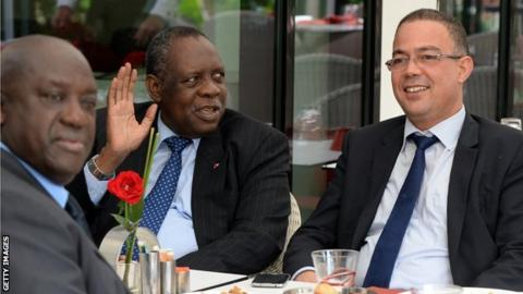 Caf president Issa Hayatou (second left) speaks to Fouzi Lekjaa (R), president of the Moroccan Football Federation (FRMF), in Rabat on 3 November, 2014