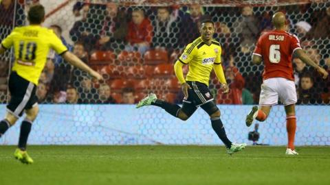 Andre Gray celebrates scoring at Nottingham Forest