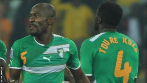 Ivory Coast's Didier Zokora and Kolo Toure