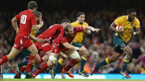 Tevita Kuridrani breaks through the Welsh defence to score