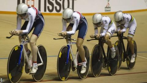 The women's team pursuit squad on their way to gold