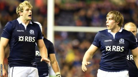 Brothers Richie (left) and Jonny scored first-half tries for Scotland at Murrayfield