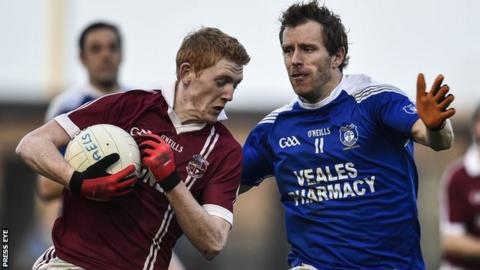 Christopher Bradley, who scored three of Slaughtneil's points, attempts to get past Cavan Gaels forward Michael Lyng