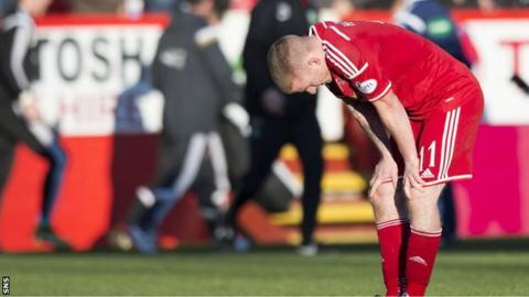 Jonny Hayes is a dejected figure at full-time