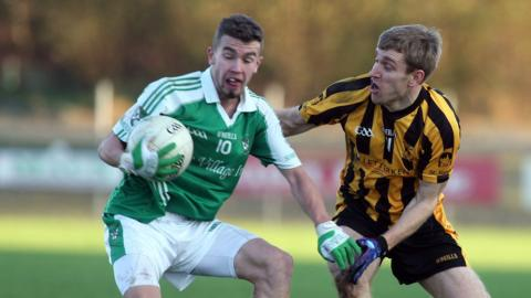 James McMahon of Roslea and St Eunan's goalscorer Conal Dunne in action at Letterkenny
