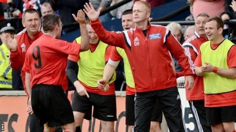 Hurlford United manager Darren Henderson celebrates a Stewart Kean goal