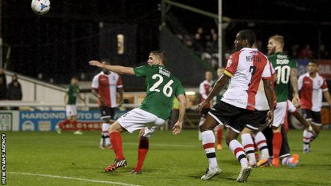 Andy Hunt gave Wrexham the lead at Woking just before half-time