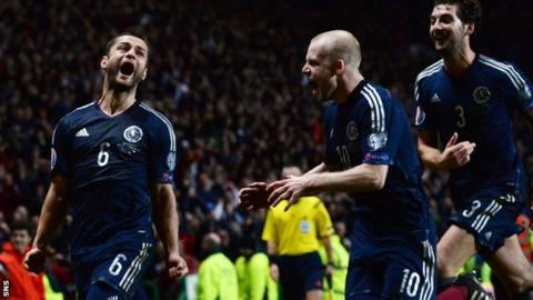 Shaun Maloney (left) celebrates his goal