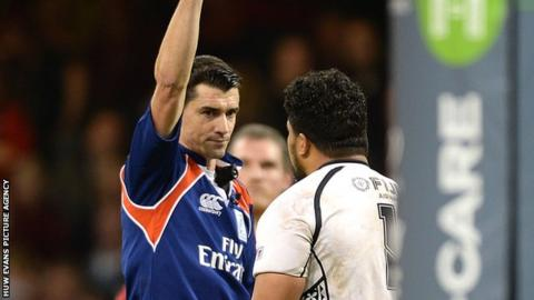 Referee Pascal Gauzere shows Campese Ma'afu a red card