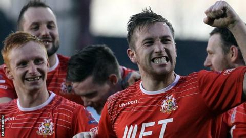 Mark McAllister celebrates after scoring Portadown's third goal against Glenavon