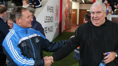 Dublin manager Jim Gavin greets Ulster's Joe Kernan before the game held to raise funds for the MND Association for research and patient care