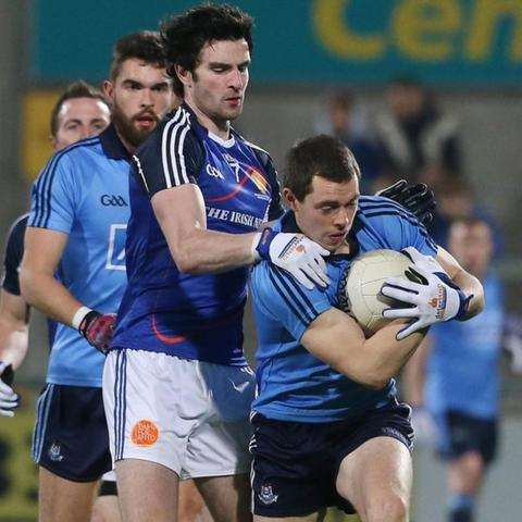 Ulster player Aaron Findon in action against Dublin's Dean Rock