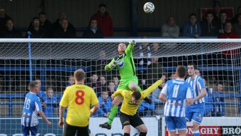 Coleraine keeper Michael Doherty punches clear in the Showgrounds game against Dungannon Swifts