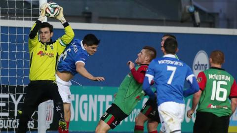 Glentoran keeper Elliott Morris catches the high ball to deny Linfield's Jimmy Callacher in the 'Big Two' clash at Windsor Park