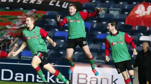 Johnny Addis runs away in delight after his late equaliser gives Glentoran a 2-2 draw against the Blues