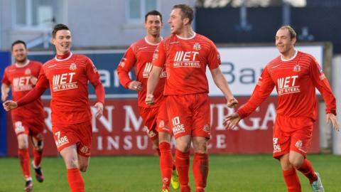 Portadown players run to congratulate Mark McAllister after he scores what proves to be the winning goal in the 3-2 victory over Glenavon