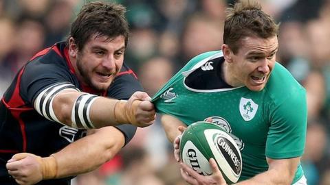 Davit Kubriashvili of Georgia tackles Ireland's Eoin Reddan
